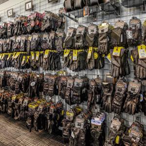 A full wall of motorcycle gloves